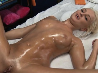 Gal spreads legs wide and begins pushing dildo in her cookie